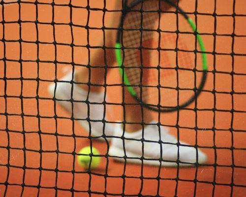 Close up of tennis racket and net